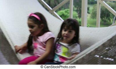 lovely girls playing in hammock