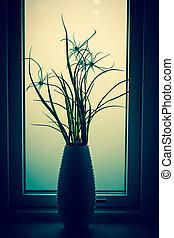Flower silhouette in a bathroom window
