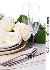 table setting with beige roses - Festive table setting with...