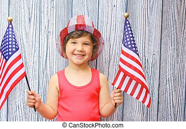 Young girl with 4th of july hat and flag