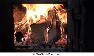fire in old furnace fireplace