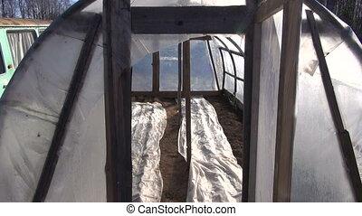 retro plastic greenhouse in spring - retro plastic...