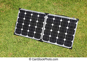 Solar Power Panels - Portable solar panels on green grass...