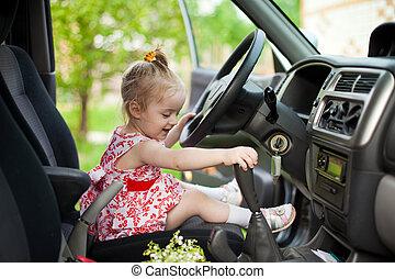 Little girl in the car - Little girl sitting in the car