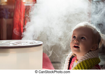 Baby and humidifier - Little baby playing with humidifier