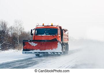 Snowplow in winter snow storm - Snowplow working in winter...