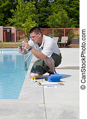 Active Pool Chemical Testing - Service man checking...