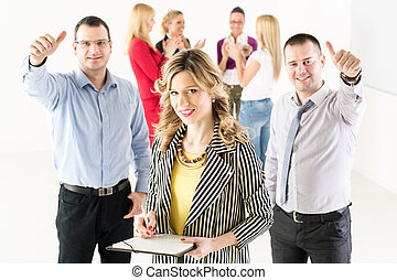 Business people - Smiling businesswoman standing in the...