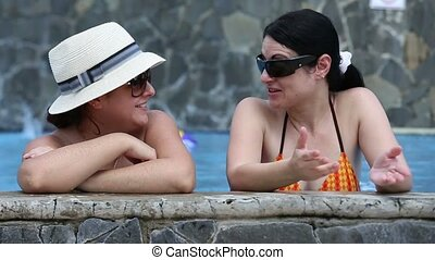 Female Friends In Swimming Pool