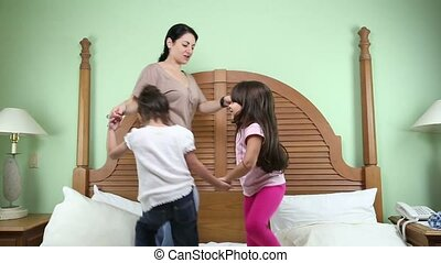 happy mother and her daughters play