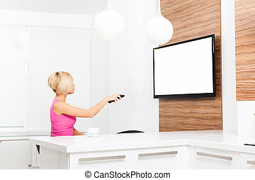 woman watching tv hold remote control changing channel,...