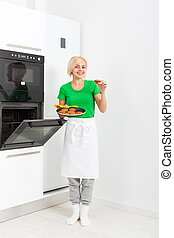 woman cooking taste cookies baking oven tray - woman cooking...