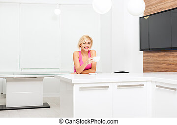 young woman hold cup of coffee kitchen - beautiful young...