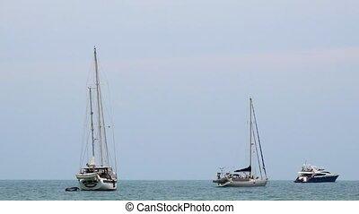 Yahts and Boats Anchored in the Sea near Sandy Beach. Gulf...