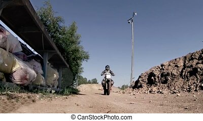 Motocross racer jumping on a motorc - racer jumping on a...