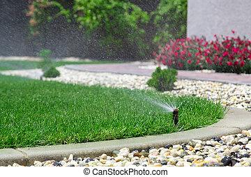 Sprinklers - Automatic sprinklers watering grass