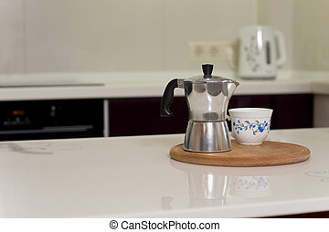 Coffee percolator and cup on a kitchen counter - Coffee...