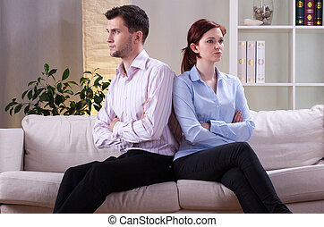 Angry marriage after quarrel in living room