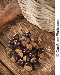 Guarana seeds on wooden table photographed with studio...