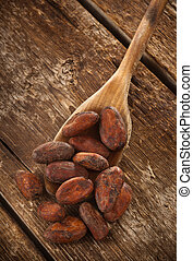 Cocoa beans on wooden table photographed with studio...