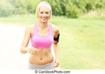 Young fit woman running