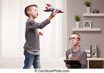 little space rocket scientists experiments - two boys playng...