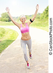 Successful woman jogging in the park - A picture of a joyful...