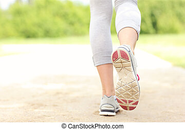 Back of jogger's legs on the path - A picture of the back of...
