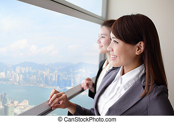 Business woman looking through window - Business woman...