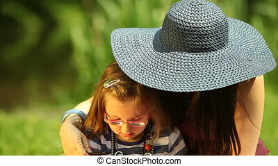 Mother combing daughter outdoor - Summer Young woman mother...
