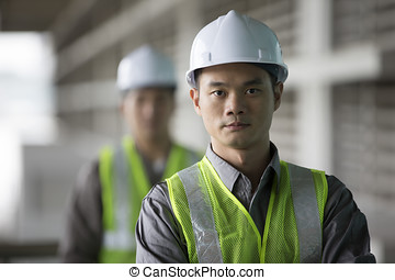 Two Asian industrial engineer's at work - Portrait of two...