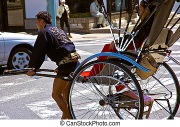Tourists take a rickshaw ride to explore the city of Kyoto...