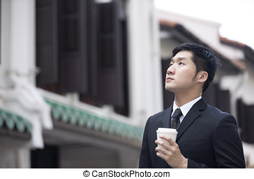 Chinese business man in Asian city. Asian businessman...