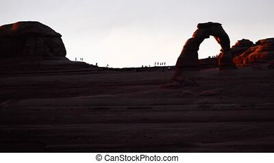 Delicate Arch Overlook at Sunset - Silhouettes of people...