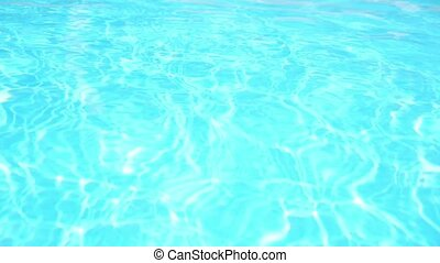Swimming Pool Background. Sun Reflection in Blue Transparent Water.