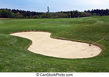 Sand trap on the golf filed