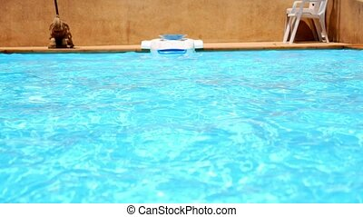 Resort Pool Water Ripples in the Sunlight. Chilling out in...