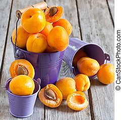 Apricots - Sweet ripe apricots in small violet buckets....