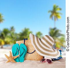 Summer accessories on sandy beach