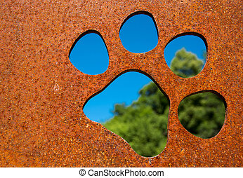 Silhouette of a cat paw in a wall - Silhouette of a cat paw...
