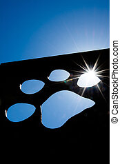 Silhouette of a cat paw with sun - Silhouette of a cat paw...