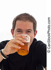 Young man drinking beer - Close up of young man drinking...