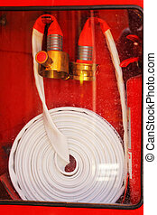 Pipe roll for fire hose emergency in red metal boxes