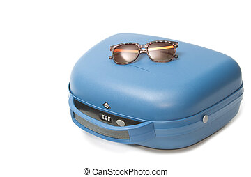 Summer travel suitcase with sunglasses