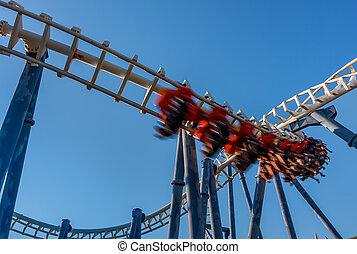 Roller coaster in Luna Park. - Roller coaster under blue sky...