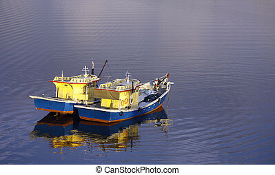 Two fishing boats floating