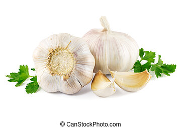 garlic with parsley leaves on a white background