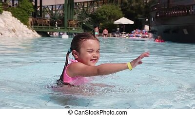Little girl having fun in a swimmin