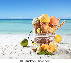 Ice cream scoops in cones with blur beach - Fresh fruit ice...