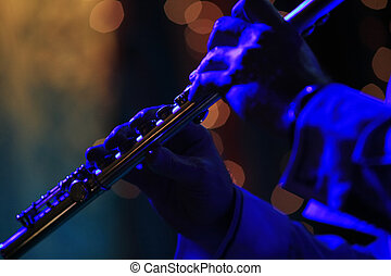 flute - Flute in hands of the musician with scenic light